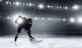 Hockey player aiming to gates at stadium